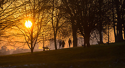 London, December 12 2017. Walkers on Primrose Hill as the sun rises on a clear very cold morning in London. © Paul Davey