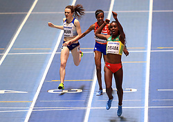 Great Britain's Laura Muir (left) crosses the line in third position during the Women's 3000m final during day one of the 2018 IAAF Indoor World Championships at The Arena Birmingham, Birmingham.