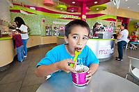 Daniel Chavez, 10, enjoys his yogurt at Menchie's in San Fernando June 1, 2012. Copyright 2012 by David Sprague