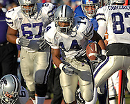Kansas State running back Leon Patton (41) brakes out of the pack for a 44-yard touchdown in the second quarter at Memorial Stadium in Lawrence, Kansas, November 18, 2006.  Kansas beat K-State 39-20.<br />