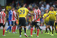 Victor Wanyama of Southampton and Etienne Capoue of Watford shaking hands after the final whistle. Barclays Premier League, Watford v Southampton at Vicarage Road in London on Sunday 23rd August 2015.<br /> pic by John Patrick Fletcher, Andrew Orchard sports photography.