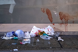 © Licensed to London News Pictures. 01/01/2021. London, UK. Medical waste lays on the group alongside blood smeared on a window at the crime scene outside Grosvenor Court Mansions on Edgeware Road. Metropolitan police were contacted by London Fire Brigade at 00:32GMT on Friday 01/01/2021 to reports of a stabbing on Edgware Road.  Police officers attended the scene along with the London Ambulance Service and an advanced trauma team car from London's Air Ambulance. Two males were identified with stab injuries and taken to a major trauma centre. A women was also located at the scene suffering with a head injury, she has been taken to hospital. Photo credit: Peter Manning/LNP