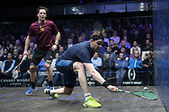 James Willstrop of England (wearing a Dark Blue shirt) plays a shot against Paul Coll of New Zealand (wearing a Maroon shirt). Canary Wharf Squash Classic 2016 , day two at the East Wintergarden in Canary Wharf , London on Tuesday 8th March 2016.<br /> pic by John Patrick Fletcher, Andrew Orchard sports photography.