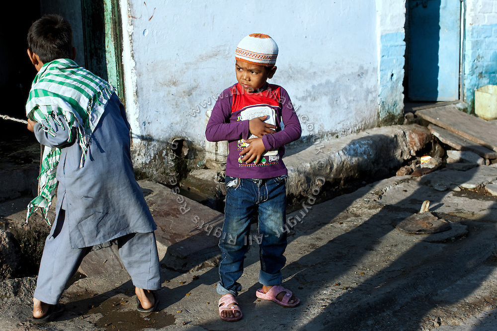 A muslim boy (centre) is going to a Madrassa (Islamic school) near New Arif Nagar, one of the water-affected colonies standing next to the abandoned Union Carbide (now DOW Chemical) industrial complex, site of the infamous 1984 gas tragedy in Bhopal, Madhya Pradesh, central India. The poisonous cloud that enveloped Bhopal left everlasting consequences that today continue to consume people's lives.