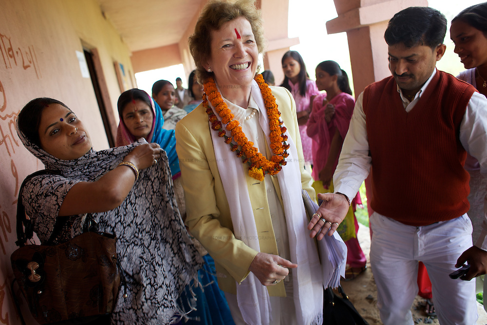 The Elders' Mary Robinson during a visit to the Jagriti porject in Dhanarua, Bihar as part of the Girls Not Brides campaign. ..The Elders are independent global leaders working together for peace and human rights. The group was founded by Nelson Mandela in 2007. Four of the The Elders,.Ela Bhatt, Mary Robinson, Desmond Tutu and Gro Brundtland spent a week in India. The primary objective of the their visit was to learn about the causes of child marriage in India, discuss the harmful impact of child marriage on human rights and development, and to encourage local efforts to end the practice. The Elders met political and business leaders, UN and NGO representatives, member of the media and communities affected by child marriage. ..Photo: Tom Pietrasik|The Elders.Dhanarua, Bihar, India.February 7th 2012
