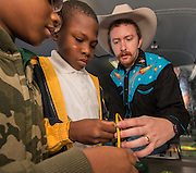 Career Cowboy Jacob Breier works with students at Pleasantville Elementary School, October 21, 2014.