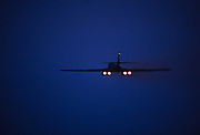 """The Rockwell B-1 Lancer is a supersonic variable-sweep wing, heavy bomber used by the United States Air Force . It is commonly called the """"Bone"""" (from """"B-One""""). It is one of three strategic bombers in the USAF fleet as of 2017, the other two being the B-2 Spirit """"Stealth Bomber"""", and the B-52 Stratofortress.<br /> <br /> The B-1 was first envisioned in the 1960s as a platform that would combine the Mach 2 speed of the B-58 Hustler with the range and payload of the B-52, ultimately replacing both. After a long series of studies, Rockwell International won the design contest for what emerged as the B-1A. This version had a top speed of Mach 2.2 at high altitude and the capability of flying for long distances at Mach 0.85 at very low altitudes. The combination of the high cost of the aircraft, the introduction of the AGM-86 ALCM cruise missile that flew the same basic profile, and early work on the stealth bomber all significantly affected the need for the B-1. This led to the program being cancelled in 1977, after the B-1A prototypes had been built.<br /> <br /> The program was restarted in 1981, largely as an interim measure while the stealth bomber entered service. This led to a redesign as the B-1B, which had lower top speed at high altitude of Mach 1.25, but improved low-altitude performance of Mach 0.96. The electronics were also extensively improved during the redesign, and the airframe was improved to allow takeoff with the maximum possible fuel and weapons load. The B-1B began deliveries in 1986 and formally entered service with Strategic Air Command  as a nuclear bomber in 1986. By 1988, all 100 aircraft had been delivered."""