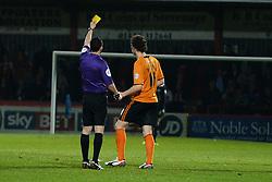 Referee Dean Whitestone shows a yellow card to Wolves midfielder Kevin McDonald   - Photo mandatory by-line: Mitchell Gunn/JMP - Tel: Mobile: 07966 386802 01/04/2014 - SPORT - FOOTBALL - Broadhall Way - Stevenage - Stevenage v Wolverhampton Wanderers - League One