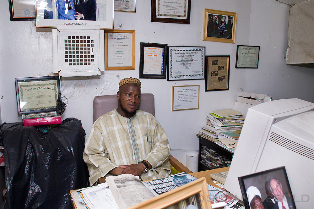 Imama Konate, originally from Cote d'Ivoire, in his office at the mosque he runs in Harlem. He is an outspoken advocate for the African community in New York.