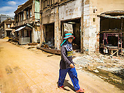 07 JUNE 2016 - BANGKOK, THAILAND: A worker walks through an urban renewal project on Yaowarat Road in Bangkok's Chinatown. The Chinatown neighborhood in Bangkok is considered by some to be one of the best preserved Chinatown districts in the world, is changing. Many of the old shophouses are being demolished and replaced by malls and condominium developments.        PHOTO BY JACK KURTZ