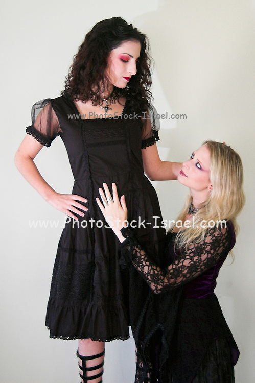 2 models wearing Gothic style clothes