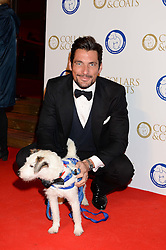 DAVID GANDY and Tyson the dog at the Collars & Coats Gala Ball in aid of Battersea Dogs & Cats Home held at Battersea Evolution, Battersea Park, London on 7th November 2013.