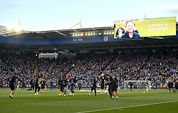 Tributes to those who lost their lives in the Leicester City helicopter crach including Leicester City Chairman Vichai Srivaddhanaprabha on the screens as Leicester City players warm up ahead of the Premier League match at the King Power Stadium, Leicester.