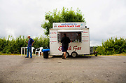 Two men at a roadside burger van on the 27th June 2008 in Somerset in the United Kingdom.