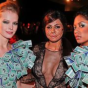 NLD/Amsterdam/20101209 - VIP avond Miljonairfair 2010, Olcay Gulsen met de door haar ontworpen jurk van creditcards van American Express