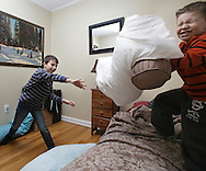 Cameron Macur, left, has a pillow fight with his cousin Noah Didonato in Ray's home in Pine Bush on Friday, March 8, 2013.