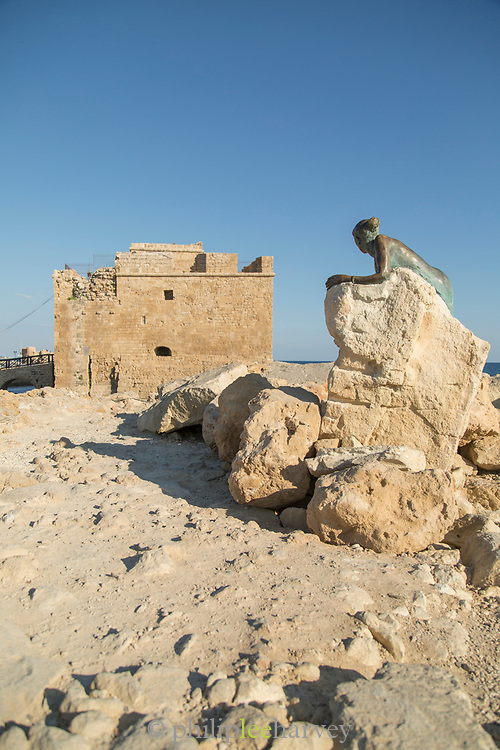 Old ruin of medieval castle with statue on rock, Paphos, Cyprus