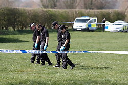 """© Licensed to London News Pictures.  29/03/2012. AYLESBURY, UK.A police search team investigates the scene of a shooting yesterday (Wed)  in Stour Close in the Walton Court area of Aylesbury, Buckinghamshire. The attack is thought to be not random. At a press conference today Thames Valley Police said they had """"no information"""" about rumours of a shootout between the gunman and the victim. They also refused to explain why the victim was taken away in handcuffs despite being seriously injured. Photo credit:  Cliff Hide/LNP"""
