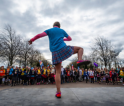 Glasgow, UK. 29 April, 2018. Start of Kiltwalk 2018 at Glasgow Green in Glasgow. Major charity fundraising walk is taking place in Scotland supported by The Hunter Foundation. Route is 23 Miles and ends at Balloch. Pictured; Fitness instructor Kerry leads participants in a warm up routine.