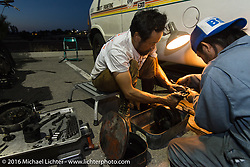 Shinya Kimura works on his Team 80 1915 Indian Twin with riding partner Yoshimasa Nimi during Stage 13 (257 miles) of the Motorcycle Cannonball Cross-Country Endurance Run, which on this day ran from Elko, NV to Meridian, Idaho, USA. Thursday, September 18, 2014.  Photography ©2014 Michael Lichter.