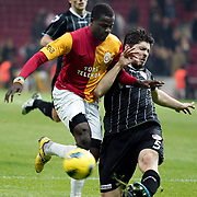 Galatasaray's Emmanuel Eboue (R) and Manisaspor's Huseyin Tok (L) during their Turkish Super League soccer match Galatasaray between Manisaspor at the TT Arena at Seyrantepe in Istanbul Turkey on Wednesday, 21 December 2011. Photo by TURKPIX