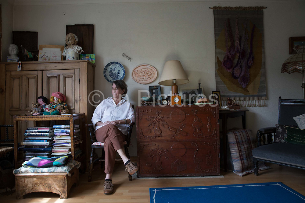 Mary Van de Water, freehold resident from Knights Walk estate on 1st June 2015 in  South London, United Kingdom. Knight's Walk is a collection of mostly bungalows; originally built for the elderly and disabled; that are a part of the Cotton Garden Estate in Kennington. Designed by architect George Finch and built between 1969-1972; the estate is currently being put forward for listing by the Twentieth Century Society.