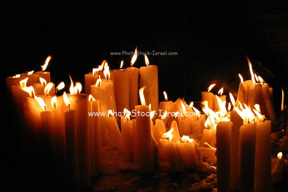 Zagreb; Croatia, lit candles in a dark church