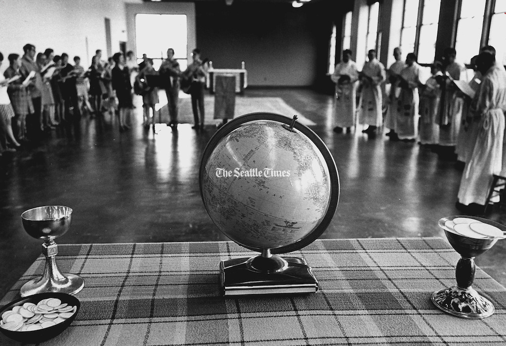 A globe was on the altar for an Earth Day Mass concelebrated by 11 Seattle University priests in 1970.  (Peter Liddell / The Seattle Times)