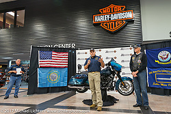 USS South Dakota commissioning committee member Lieutenant Tom Muenster, USN Ret of Sioux Falls at J and L Harley-Davidson after the unveiling of the 2018 Harley-Davidson Street Glide donated by the Motor Company and customized by J and L to commemorate the christening of the USS South Dakota submarine. Sioux Falls, SD. USA. Monday October 9, 2017. Photography ©2017 Michael Lichter.