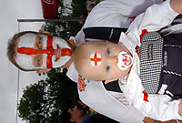 Photo: Steve Holland.<br />Australia v England. Rugby World Cup Final, at the Telstra Stadium, Sydney. RWC 2003. 22/11/2003. <br />An England fan with his baby.