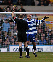 Fotball<br /> England 2004/2005<br /> Foto: SBI/Digitalsport<br /> NORWAY ONLY<br /> <br /> Nottingham Forest v Queen's Park Rangers<br /> Coca Cola Championship. 04.12.2004<br /> <br /> QPR's George Santos (R) expresses his anger at referee L Mason as he is shown the yellow card.