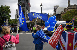 © Licensed to London News Pictures. 25/09/2019. London, UK. Anti Brexit protestors gather outside the Houses of Parliament in Westminster on the day that MPs return. The Supreme Court in London yesterday ruled that Parliament had been suspended illegally after British Prime Minster Boris Johnson prorogued parliament just weeks before the UK is due to leave the EU on October 31st. Photo credit: Ben Cawthra/LNP