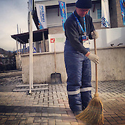 A man sweeps outside the Gorki Media Center on Sunday, Feb. 9, 2014. Photographed during the Winter Olympics in Sochi, Russia with an iPhone and Instragram. (Brian Cassella/Chicago Tribune) B583527420Z.1 <br /> ....OUTSIDE TRIBUNE CO.- NO MAGS,  NO SALES, NO INTERNET, NO TV, CHICAGO OUT, NO DIGITAL MANIPULATION...