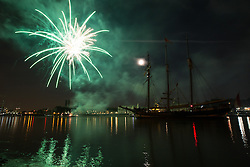 © Licensed to London News Pictures. 08/09/2014.  On the final evening of the Royal Greenwich Tall Ships Festival, a stunning fireworks display lit up the sky with the help of a huge moon. Credit : Rob Powell/LNP