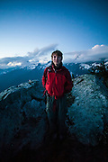 Ian Derrington stands on the summit of Salvation Peak, North Cascades National Park, Washington.