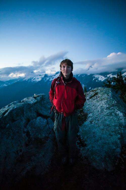 Ian Derrington stands on the summit of Salvation Peak, North Cascades National Park, Washington.