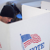 Joe Colaianni fills out his ballot for the Municipal Election at the Second Street fire station in Gallup Tuesday.
