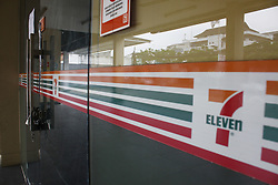 June 24, 2017 - Depok, West Java, Indonesia - One of 7 Eleven convenience stores closed in Depok, West Java. The management of PT Modern International officially announced the closure of almost 7 Eleven convenience stores operated by its subsidiary PT Modern Sevel Indonesia at the end of June 2017. The closing of the outlet was due to the company's continued losses since 2015, which caused the limited resources owned by the company to support the 7-Eleven outlet operations. The situation was worsened after the material transaction plan for the sale and transfer of the restaurant and convenience store segment by PT Charoen Phokphand Restu Indonesia was canceled. (Credit Image: © Tubagus Aditya Irawan/Pacific Press via ZUMA Wire)