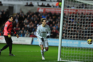 Swansea city's Michu scores the 1st goal past QPR keeper Julio Cesar. Barclays Premier league, Swansea city v Queens Park Rangers at the Liberty Stadium in Swansea, South Wales on Saturday  9th Feb 2013. pic by Andrew Orchard, Andrew Orchard sports photography,