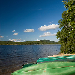 Canoes on a beach at  Katahdin Lake in Maine's Baxter State Park.  Katahdin Lake Wilderness Camps.