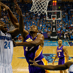 April 28, 2011; New Orleans, LA, USA; New Orleans Hornets power forward Carl Landry (24) shoots over Los Angeles Lakers center Andrew Bynum (17) during the first quarter quarter in game six of the first round of the 2011 NBA playoffs at the New Orleans Arena. The Lakers defeated the Hornets 98-80 to advance to the second round of the playoffs.   Mandatory Credit: Derick E. Hingle