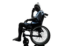 one injured man on the telephone surprised in wheelchair in silhouette studio on white background