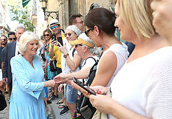 The Duchess of Cornwall greets well-wishers during a guided tour of Old Havana, in Havana, Cuba.