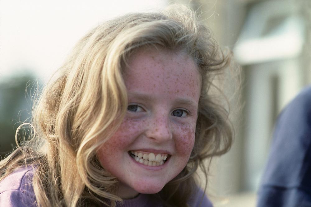 Ireland, Young schoolgirl smiles in rural classroom in County Galway