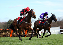 The Knot Is Tied ridden by jockey Bryony Frost (left) and Le Milos ridden by jockey Alan Johns (right) and goes onto win the Get Switched On With Matchbook Juvenile Handicap Hurdleat Sandown Park Racecourse, Esher.