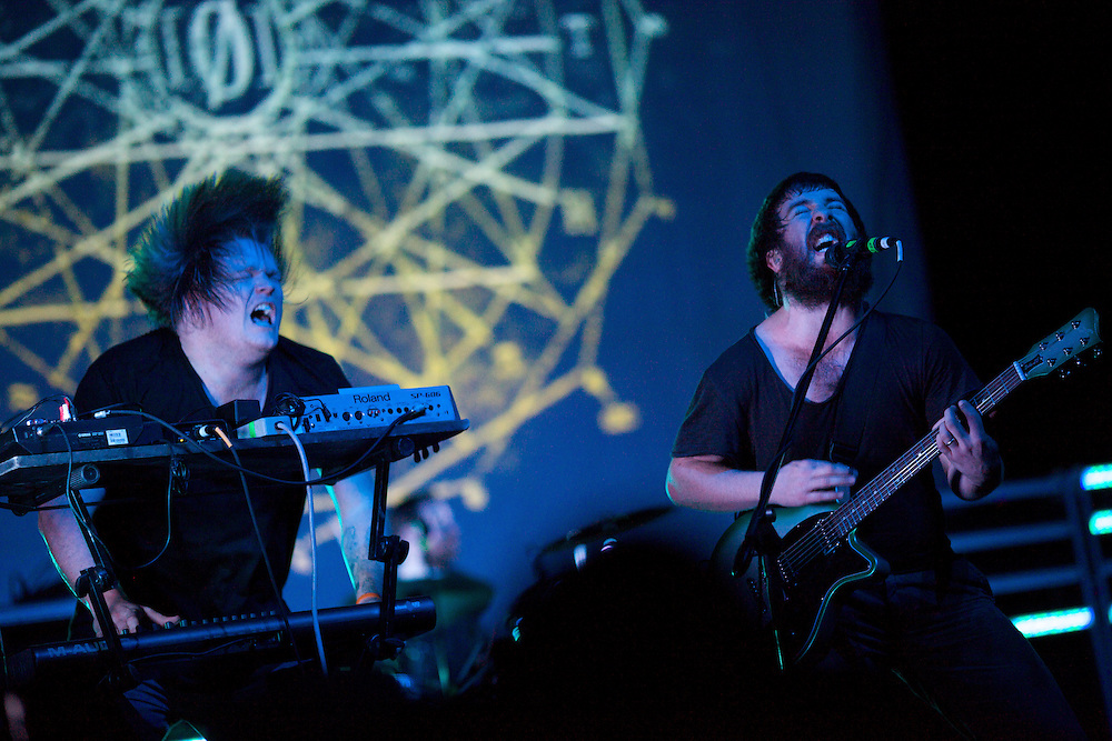 Underoath's Tim McTague, right, and Christopher Dudley perform at Terminal 5 in Manhattan, Thursday, February 17, 2011.