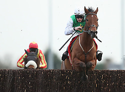 Tintern Theatre ridden by Sam Twiston-Davies jumps the last to win the 32Red.com Handicap Steeple Chase during day two of the 32Red Winter Festival at Kempton Park, Sunbury on Thames.