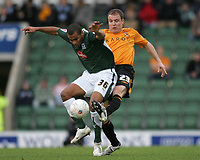 Photo: Lee Earle.<br /> Plymouth Argyle v Hull City. FA Cup Third Round. 05/01/2008. <br /> Hull's Sam Collins (R) battles with Jermaine Easter.