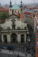 View of church and people on the pavement, from the tower on Charles bridge, Prague city, Czech Republic<br />
