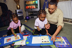 Mother playing together with twin daughters,